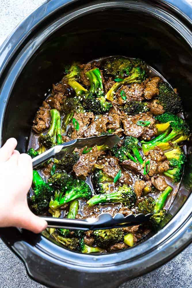 Slow Cooker Beef and Broccoli – an easy set and forget Chinese takeout favorite made in the crock-pot perfect for busy weeknights. Best of all, the beef cooks up melt-in your mouth delicious in a rich and savory sauce. Recipe also includes Instant Pot directions.