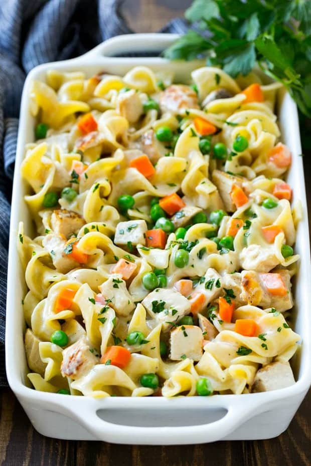 This easy chicken noodle casserole is a complete meal in one pan with chicken, veggies and egg noodles all baked together in a creamy sauce!