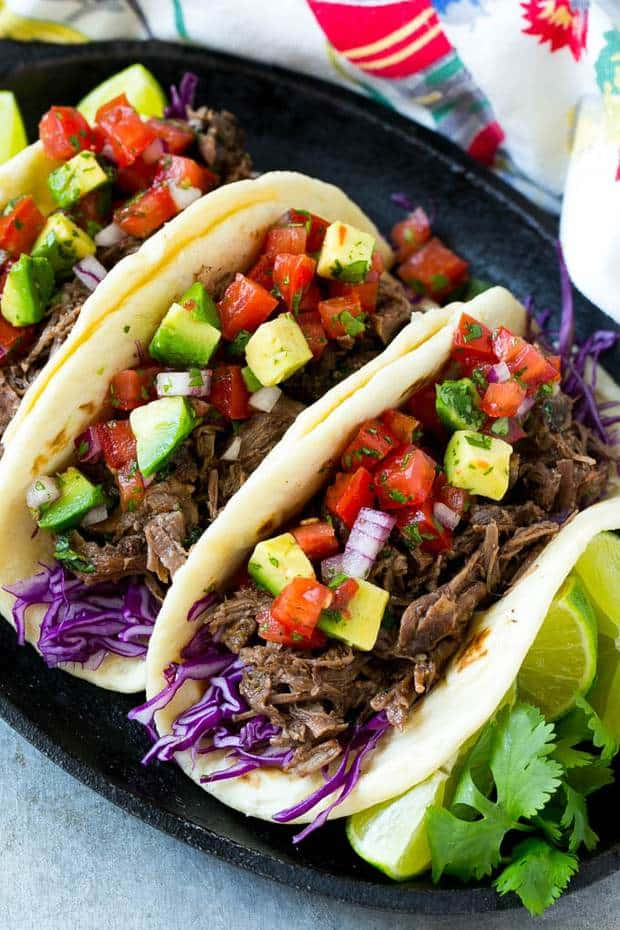 This slow cooker barbacoa beef recipe is so easy to make and is the perfect filling for tacos, burritos, enchiladas and more!