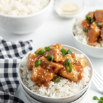 bowl of crockpot orange chicken with rice