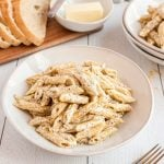 Creamy Garlic Pasta on plate and sliced bread